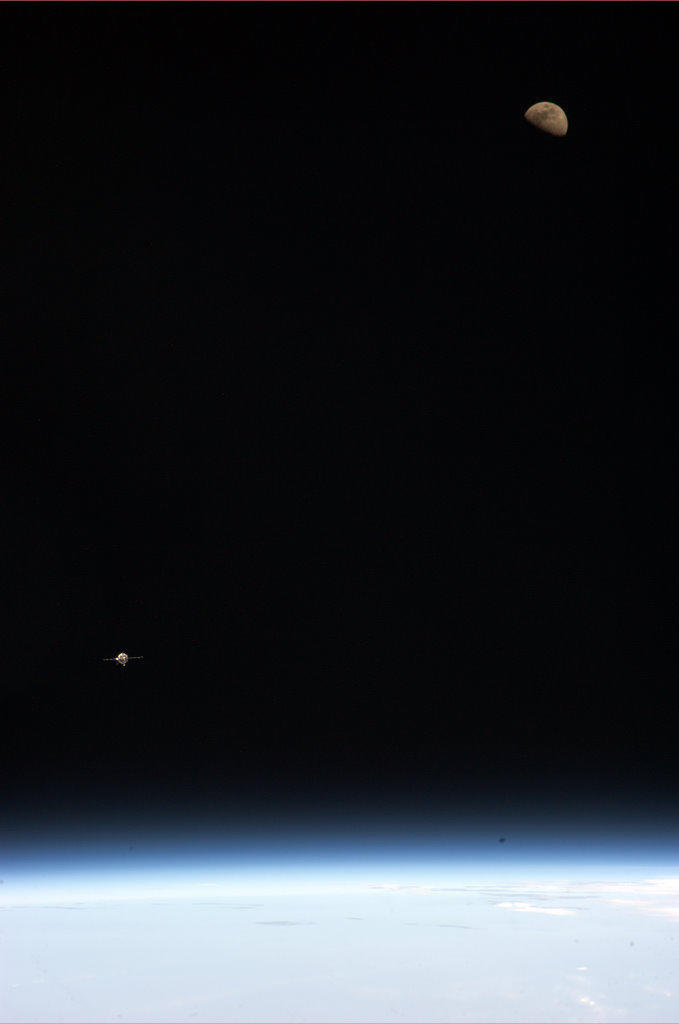 December 31, 2012: Earth, Moon and Soyuz: Kevin Ford took this picture as we approached Station last week. Science fiction into fact.