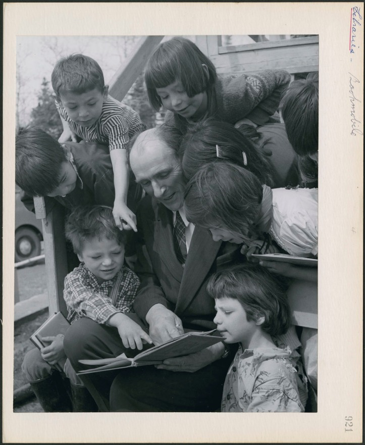 Librarian reads to a group of children in Northern Ontario, Canada (1930-1960) Credit: Canada. Dept. of Manpower and Immigration / Library and Archives Canada