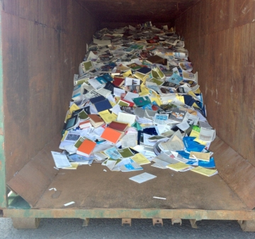 Books and reports from a government library in the dumpster.